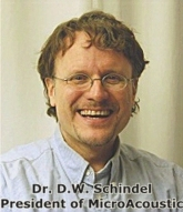A photograph of Dr. David W. Schindel, founder and president of MicroAcoustic.